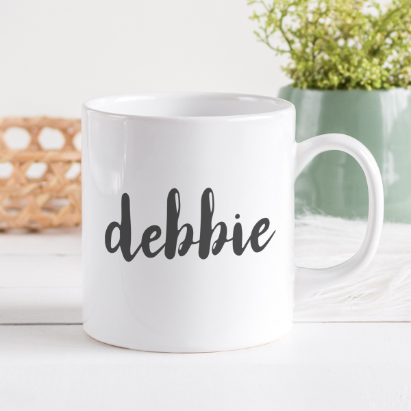 Persomalised mug with black handwritten text